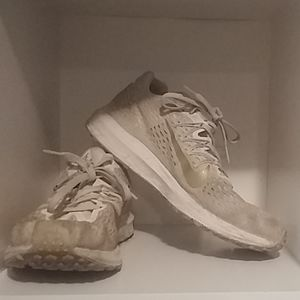 Gold Nike running shoes